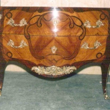 Louis XV style commode stamped by Rousseau